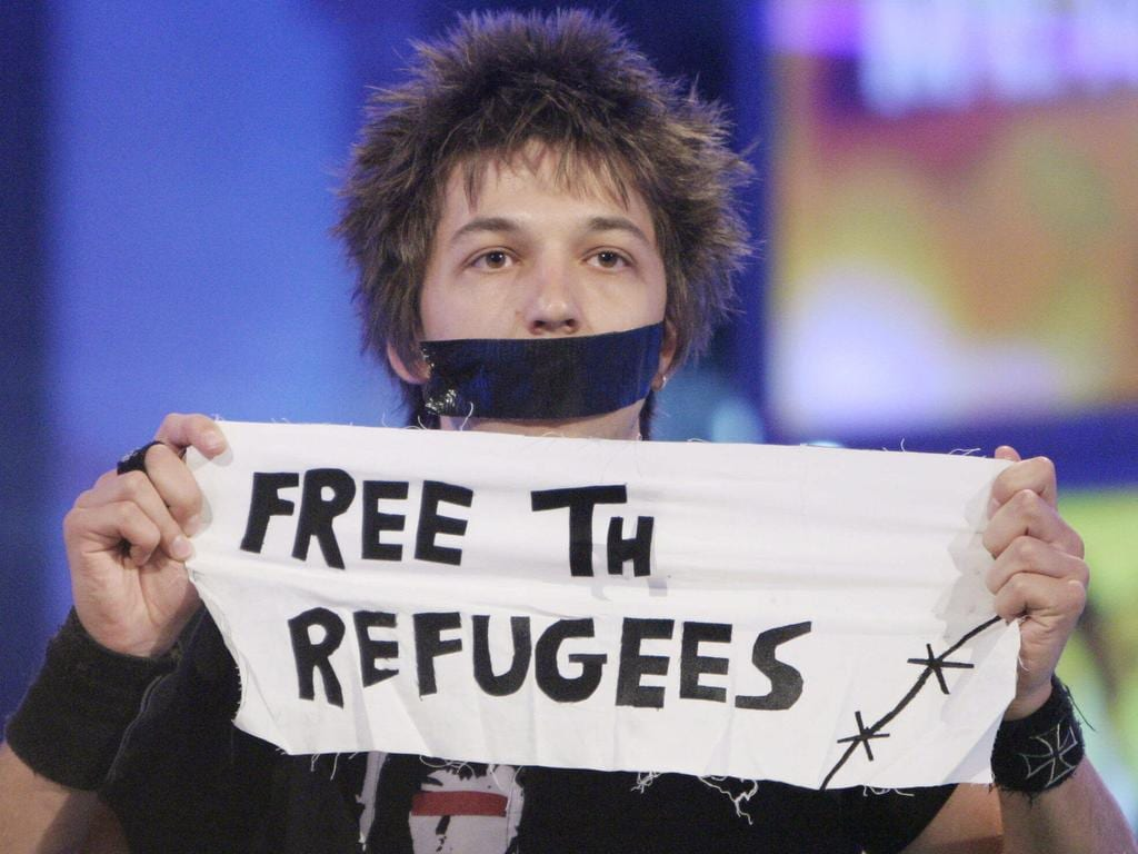 Big Brother housemate Merlin makes a political statement after being evicted in 2004.