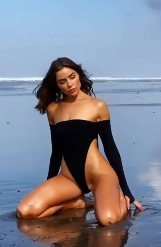 Here she is wearing a long-sleeve one-piece with an extremely high front cut.