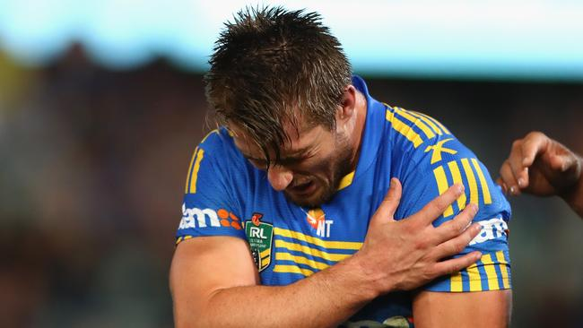 Kieran Foran leaves the field injured.