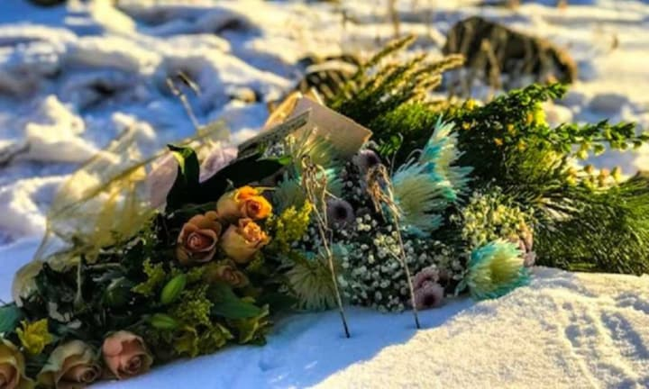 They placed flowers for their lost baby at the lake.