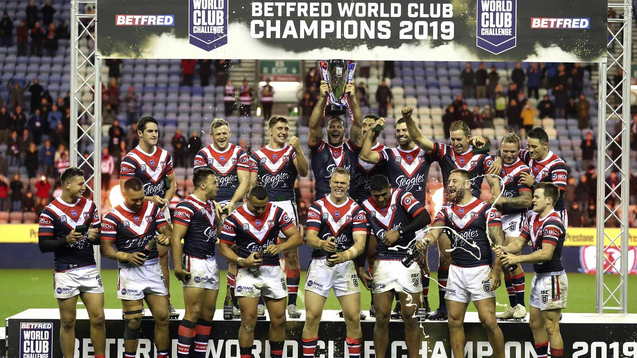 Sydney Roosters players celebrate with the trophy after winning the World Club Challenge.
