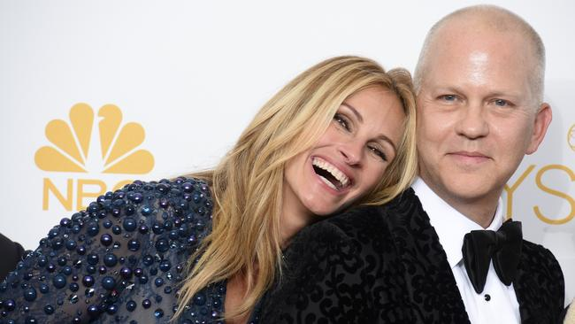 Rest your head ... Julia Roberts leans on Ryan Murphy in the press room at the Emmy Awards. Picture: AP