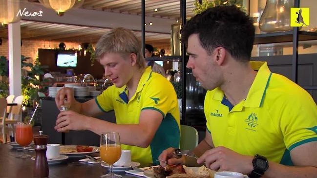 Gold medal cyclist Alex Porter and fellow cyclist Nathan Hart at breakfast after Day 1 of the Games