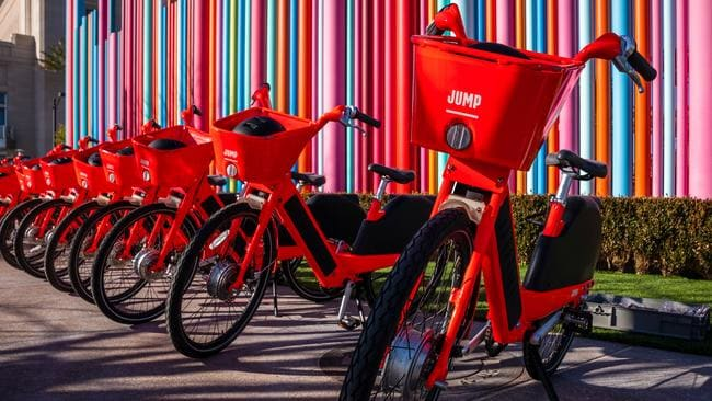 "Uber has announced plans to bring its bright orange Jump e-bicycles to ""multiple"" cities in Australia. The vehicles have a top speed of more than 30km/h. Picture: Jennifer Dudley-Nicholson"