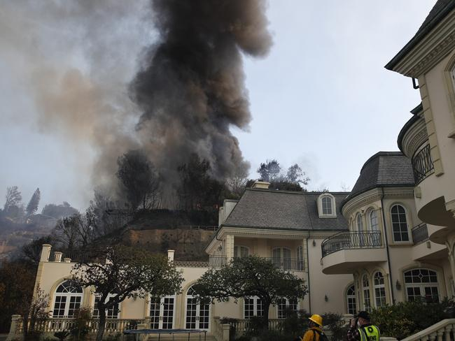 A fire burns in the exclusive Bel Air district of Los Angeles. Picture: AP