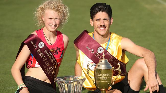 Teenage rampage: Liv Ryan and Matthew Rizzo with their trophies after winning their respective Stawell Gift finals. Picture: Getty Images