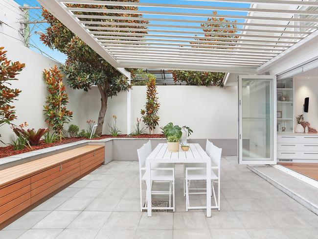 The private terrace with Vergola, opening from the living areas.