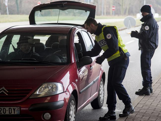 Police officers control cars at the boarder crossing at the highway A35 between Woerth (Germany) and Strassbourg the day after a man shot 14 people. Picture: Getty