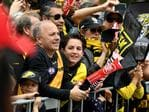 Football fans line up to watch the AFL Grand Final parade in Melbourne on Friday. Picture: AAP Image/Julian Smith