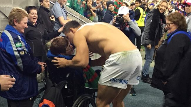 All class: Sam Burgess gives his jersey to a Knights fan.