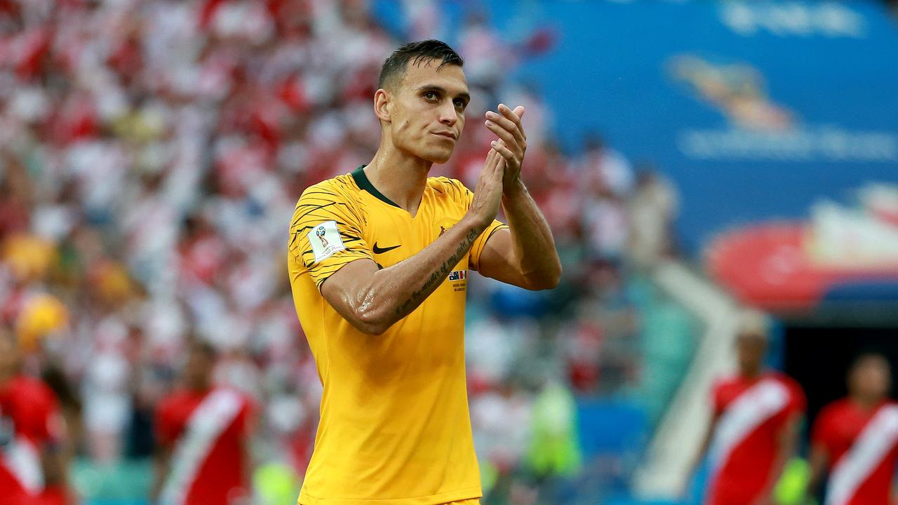 Trent Sainsbury applauds the supporters.
