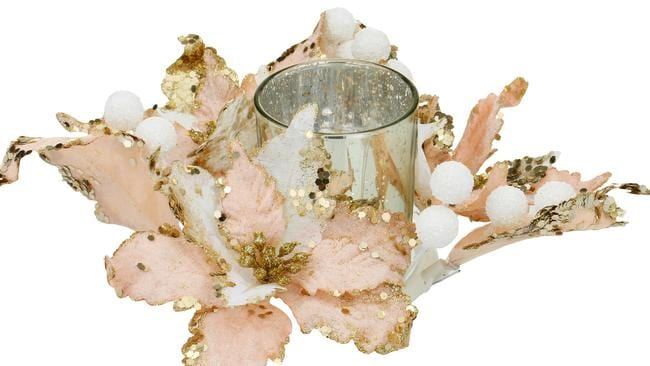 The Christmas wreath candle holders were sold in pink and gold as well as green and silver.