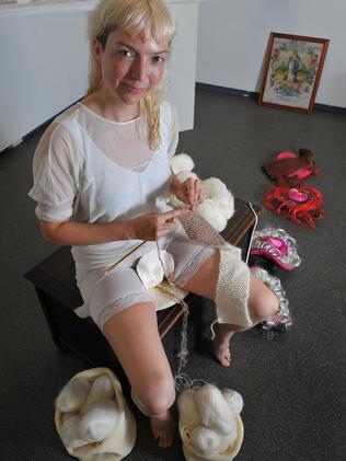 """Casey Jenkins knitting as part of her """"live art exhibition"""" she took on tour around Australia."""