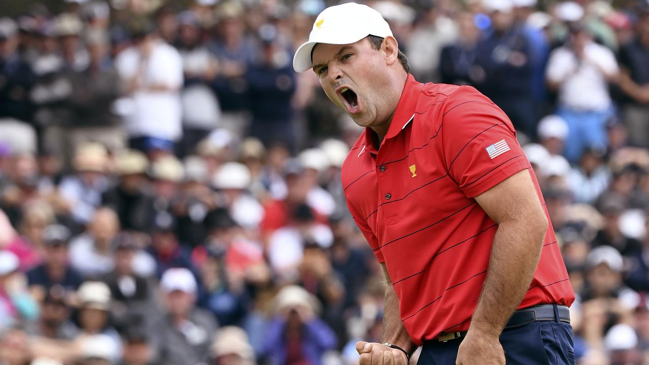 Patrick Reed reacts after sinking a birdie putt on the final day of the Presidents Cup. (Photo by WILLIAM WEST / AFP)