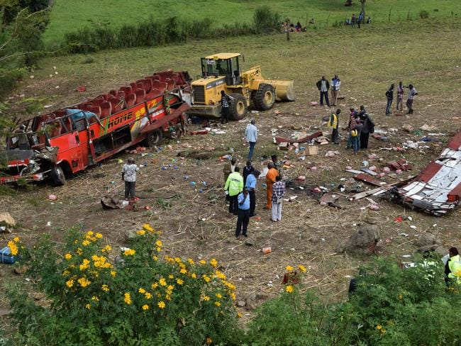 Kenyan emergency personnel and security forces inspect the wreckage of a bus at the site of an accident in Kericho, western Kenya. Picture: AFP