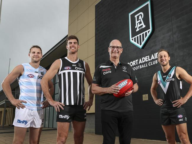 David Koch and several Port Adelaide players show off the new look.