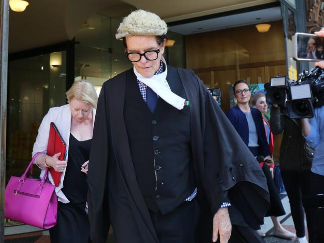 Barrister Charles Waterstreet leaves the Downing Centre after losing his defence case for axe attacker Evie Amati. Picture: Paul Braven
