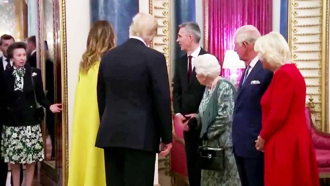The Queen appears to gesture towards Princess Anne after the chat with Donald Trump. Picture: The Sun