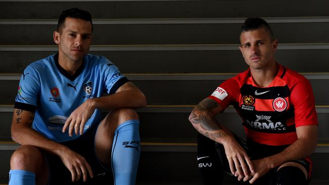 Players Nicolás Martínez of the Western Sydney Wanderers (right) and Bobo of Sydney FC.