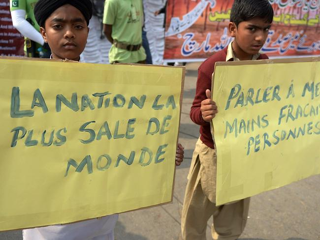 'Foulest nation' ... the demonstrators, many of them children, carried placards condemning the satirical magazine and shouted slogans. Picture: AFP/ Rizwan Tabassum