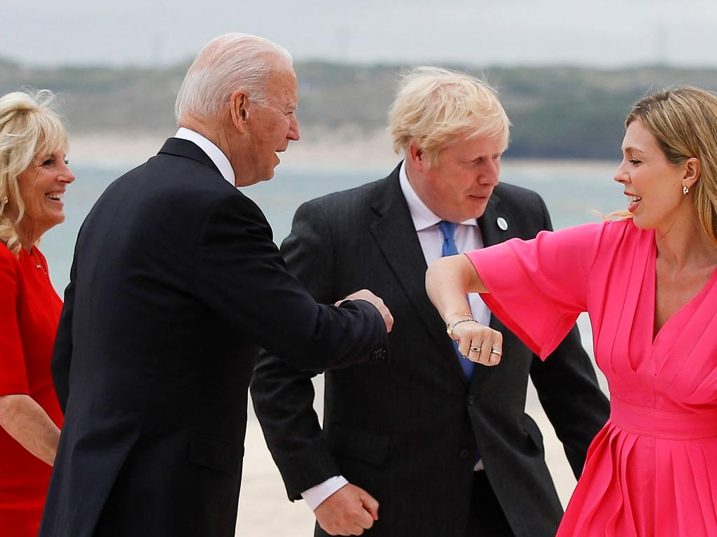 Britain's Prime Minister Boris Johnson (2R) and his spouse Carrie Johnson (R) greet US President Joe Biden (2L) and first lady Jill Biden during the G7 summit in Carbis Bay, Cornwall.