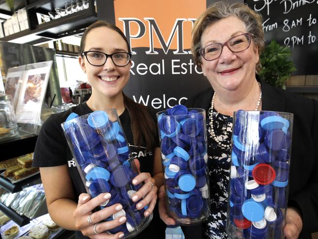 PMM Senior Property consultant, Michelle Blom (right) and Rhyme Street Cafe team member, Willow Wright with some of the plastic bottle tops they have collected.