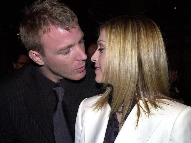 In the early days, the pair weren't shy in showing their affection. Pictured here in 2001 at the premiere of Guy's film, Snatch.