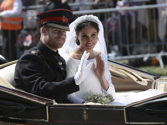 Britain's Prince Harry and Meghan Markle ride in an open-topped carriage after their wedding ceremony in May 2018. Picture: AP