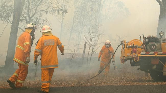 Rural Fire Brigade fighting part of the Pechey bushfire at Mount Jockey Rd, Ravensbourne on Saturday. Picture: Liam Kidston.