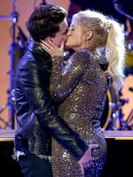 Charlie Puth and Meghan Trainor kiss onstage during the 2015 American Music Awards at Microsoft Theater on November 22, 2015 in Los Angeles, California. Picture: AFP