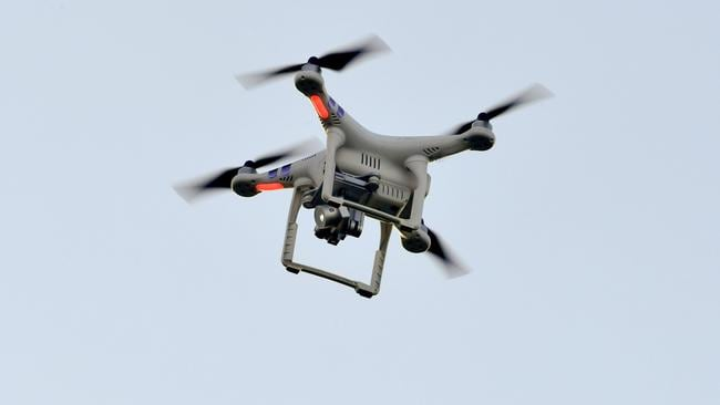 Drones can be a concern but you shouldn't shoot them, according to police. Picture: Nicolas Tucat / AFP