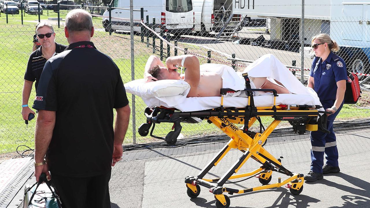 Tim Browne is taken away by ambulance after suffering a freak bowel injury. Picture: Brett Costello