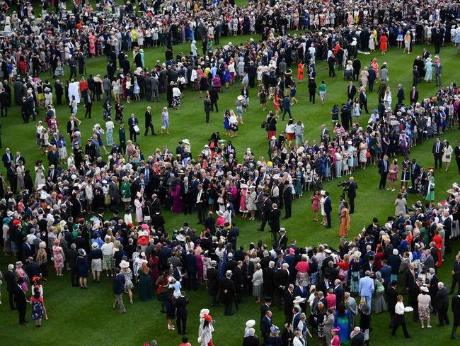 Guests attend a garden party in the grounds of Buckingham Palace in central London. Picture: AFP