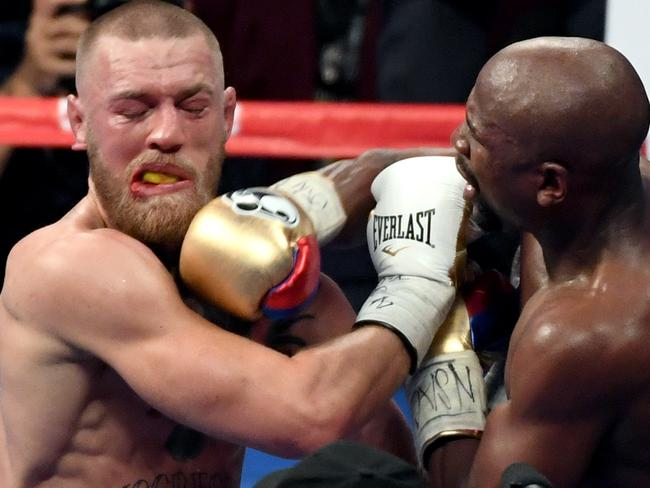 Floyd Mayweather hits Conor McGregor in the ninth round of their super welterweight boxing match. Picture: Ethan Miller/Getty Images/AFP
