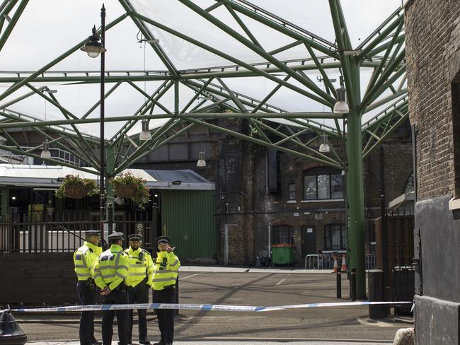 Police guard the normally bustling Borough Market which is still closed following the terror attack. Picture: Dan Kitwood/Getty Images
