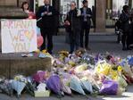 Floral tributes are seen in Manchester, England, Tuesday May 23, 2017, the day after the terror attack at an Ariana Grande concert. Picture: AP