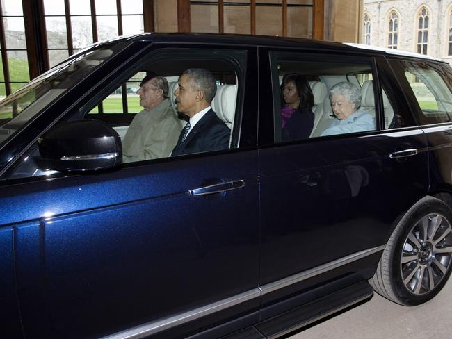 Prince Philip drives the Queen and the Obamas to a private lunch at Windsor Castle in 2016. Picture: Getty Images