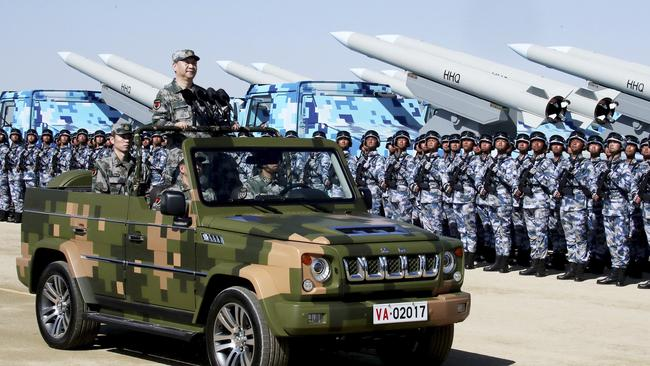 China's newest armed missiles dwarf soldiers as Chinese President Xi Jinping inspects the parade. Picture: Li Tao/Xinhua via AP