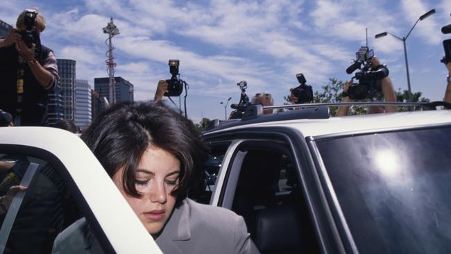 Monica Lewinsky surrounded by photographers as she gets into car on her way to the FBI Headquarters in the 1990s. Picture: Getty