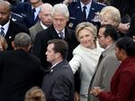 Former Democratic presidential nominee Hillary Clinton winks and shakes hands with President Barack Obama as former president Bill Clinton and Michelle Obama look on at the West Front of the U.S. Capitol on January 20, 2017 in Washington, DC. Picture: AFP