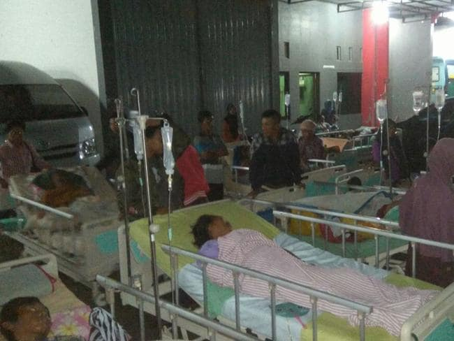 Patients are evacuated outside a hospital following an earthquake in Banyumas, Central Java, Indonesia. Picture: AP.