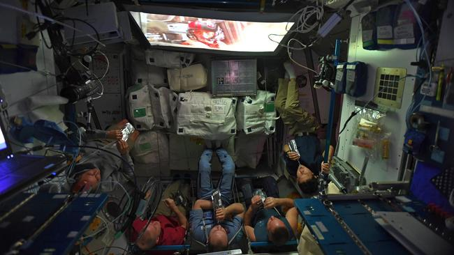 Astronauts watch a movie while on the ISS.