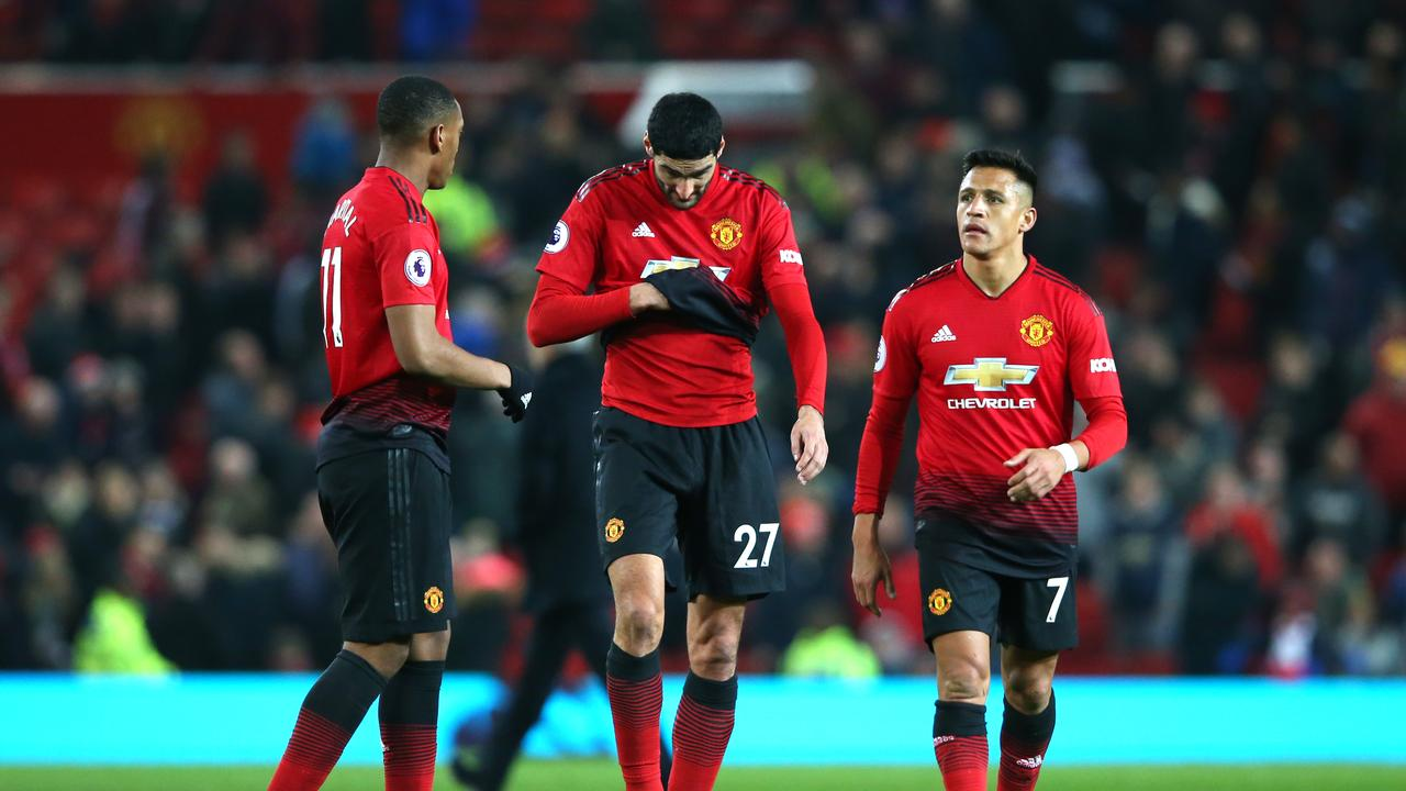 Alexis Sanchez, Anthony Martial and Marouane Fellaini of Manchester United look dejected