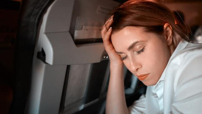 how to get the best sleep on a plane