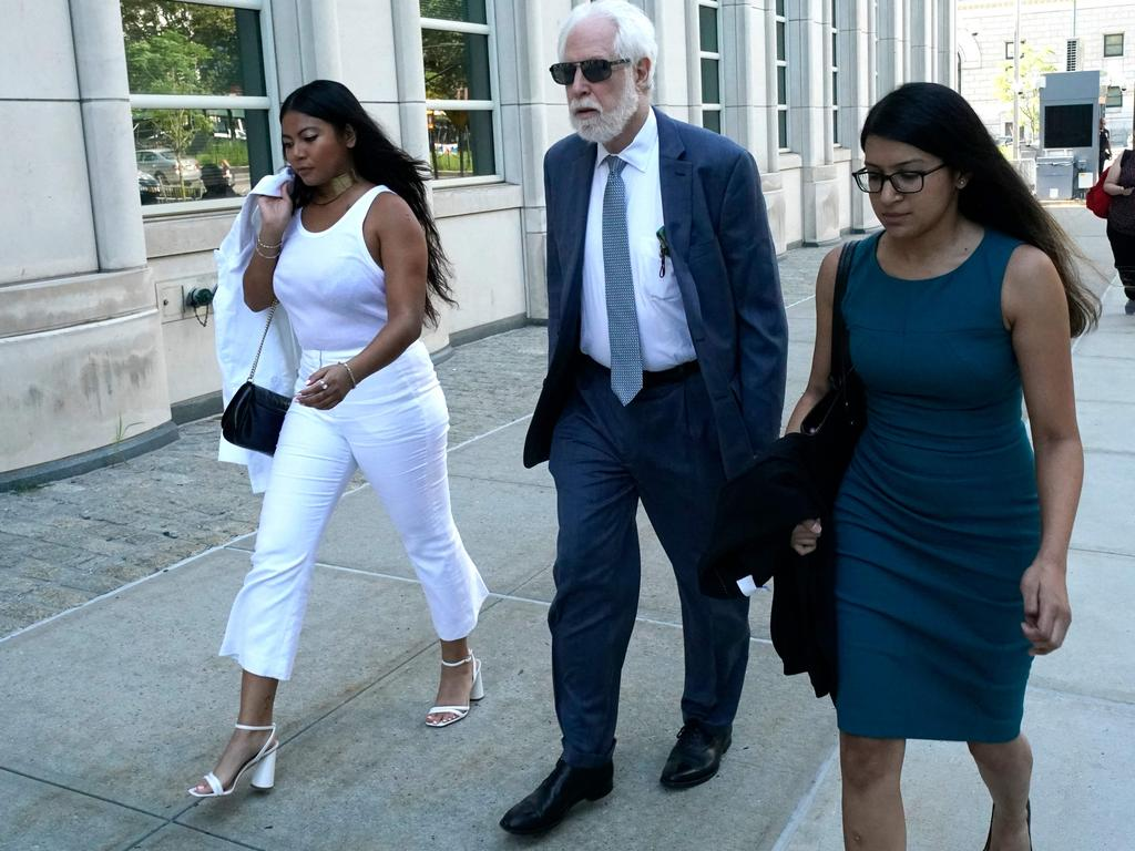 Jessica Joan (L), one of Keith Raniere's victims, arrives for the sentencing of German-born American TV actress Allison Mack at Brooklyn Federal Court