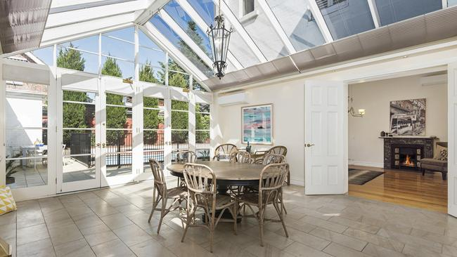 The glass roof above the conservatory is a more modern addition.