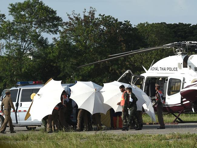 The final boys were evacuated by ambulance and helicopter to join their teammates at a Chiang Rai hospital. Picture: AFP Photo / Lillian Suwanrumpha