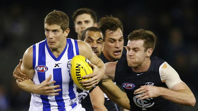 Nick Dal Santo gets gang tackled against the Blues. Picture: Michael Klein
