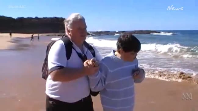 Russell Milne takes his daughter Yoey to the beach for the first time (ABC)
