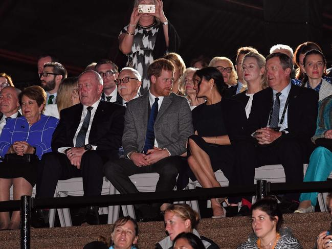 Prince Harry and wife Meghan look affectionate during the opening ceremony of the Invictus Games in Sydney. Picture: Saeed Khan